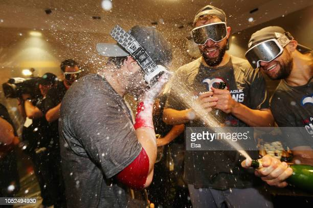 Andrew Benintendi of the Boston Red Sox celebrates with teammates in the clubhouse after defeating the Houston Astros 4-1 in Game Five of the...