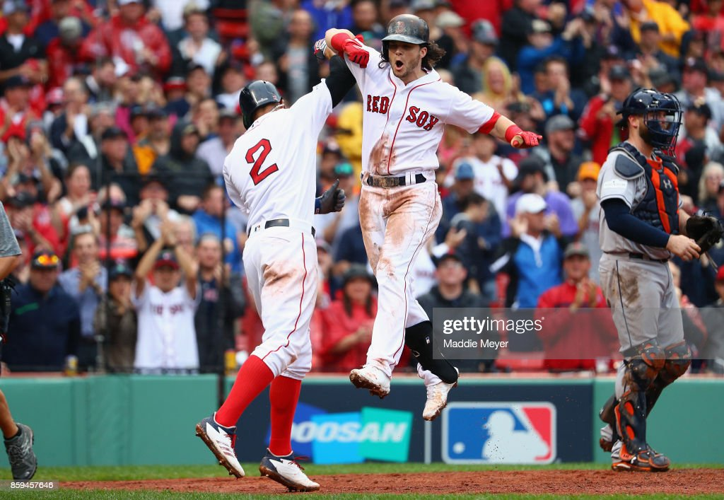Andrew Benintendi #16 of the Boston Red Sox celebrates with Xander Bogaerts #2 after hitting a two-run home run in the fifth inning against the Houston Astros during game four of the American League Division Series at Fenway Park on October 9, 2017 in Boston, Massachusetts.