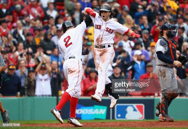 Andrew Benintendi of the Boston Red Sox celebrates with Xander Bogaerts after hitting a tworun home run in the fifth inning against the Houston...