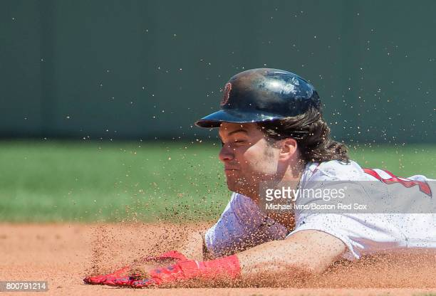 Andrew Benintendi of the Boston Red Sox dives into second base attempting to stretch a single into a double against the Los Angeles Angles of Anaheim...