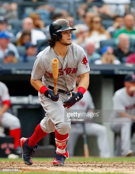 Andrew Benintendi of the Boston Red Sox follows through on a third inning three run home run against the New York Yankees at Yankee Stadium on August...