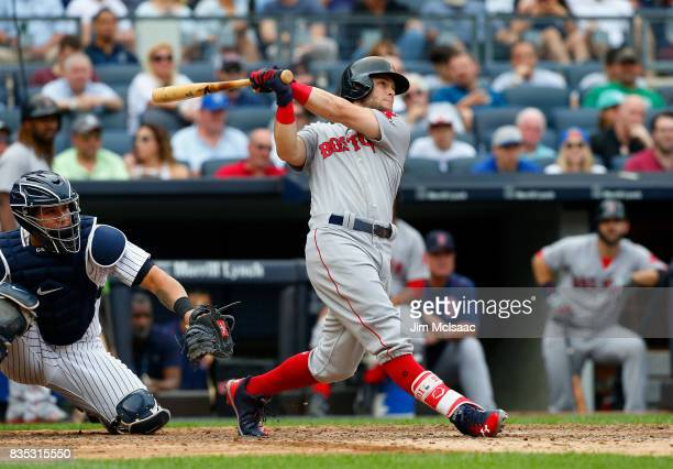 Andrew Benintendi of the Boston Red Sox follows through on his fifth inning three run home run against the New York Yankees at Yankee Stadium on...