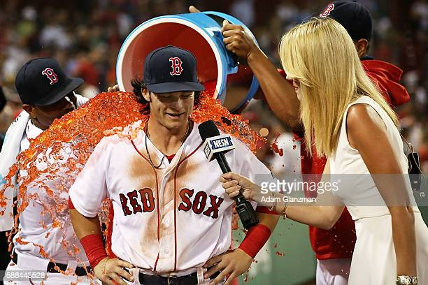 Andrew Benintendi of the Boston Red Sox has Powerade dumped on him during a post game interview with NESN reporter Guerin Austin after the victory...