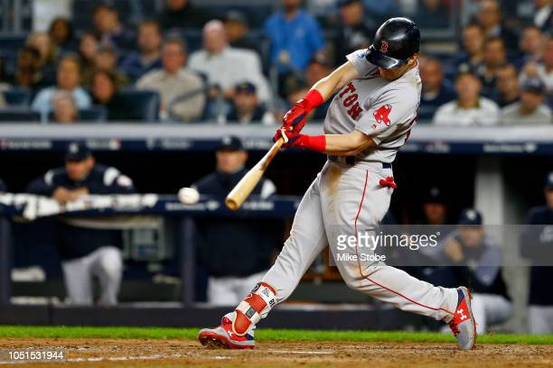 Andrew Benintendi of the Boston Red Sox hits a 3 RBI double against Lance Lynn of the New York Yankees during the fourth inning in Game Three of the...