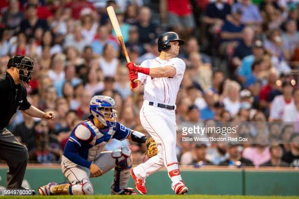 Andrew Benintendi of the Boston Red Sox hits a double during the third inning of a game against the Texas Rangers on July 9 2018 at Fenway Park in...