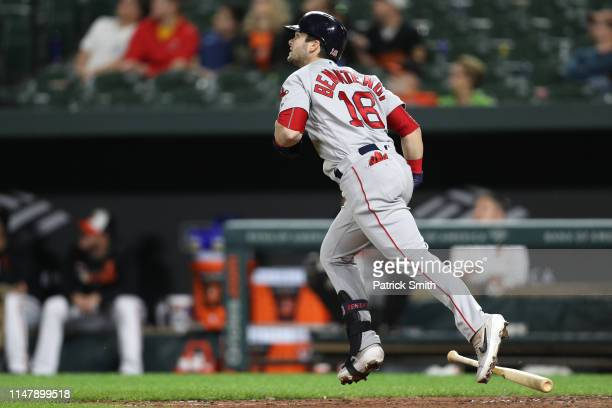 Andrew Benintendi of the Boston Red Sox hits a solo home run against the Baltimore Orioles during the twelfth inning at Oriole Park at Camden Yards...
