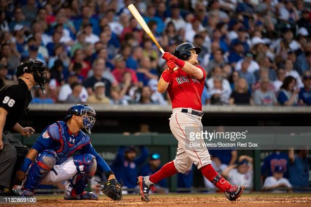 Andrew Benintendi of the Boston Red Sox hits a solo home run during the third inning of a spring training game against the Chicago Cubs on March 25...