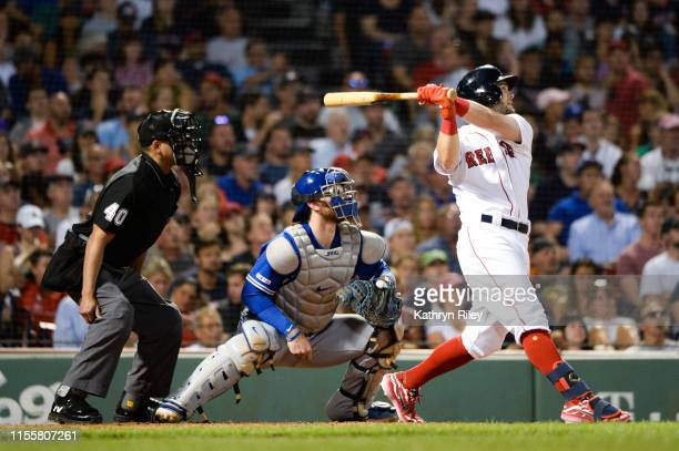 Andrew Benintendi of the Boston Red Sox hits a two run RBI double in the third inning against the Toronto Blue Jays at Fenway Park on July 15 2019 in...