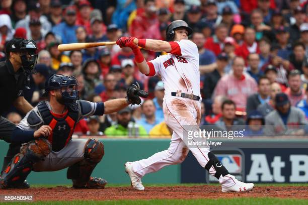 Andrew Benintendi of the Boston Red Sox hits a tworun home run in the fifth inning against the Houston Astros during game four of the American League...