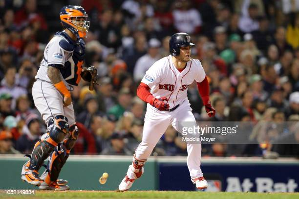 Andrew Benintendi of the Boston Red Sox hits an RBI single during the first inning against the Houston Astros in Game Two of the American League...