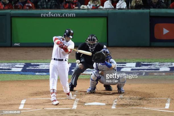 Andrew Benintendi of the Boston Red Sox hits an RBI single during the first inning against the Los Angeles Dodgers in Game One of the 2018 World...