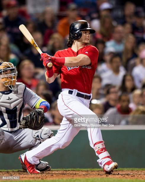 Andrew Benintendi of the Boston Red Sox hits an RBI single during the fourth inning of a game against the Tampa Bay Rays on September 8 2017 at...