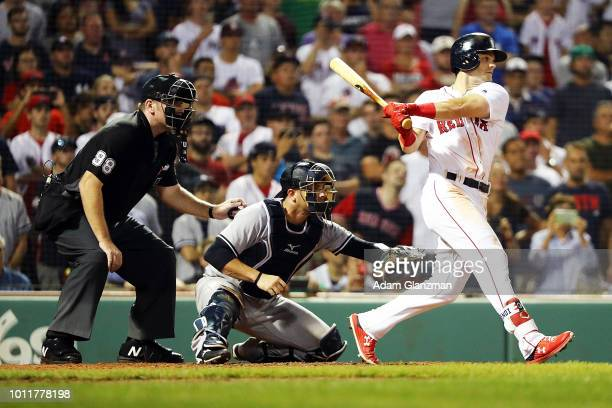 Andrew Benintendi of the Boston Red Sox hits the gamewinning walkoff single to defeat the New York Yankees in the tenth inning at Fenway Park on...