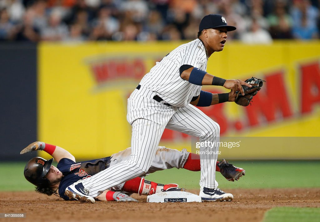 Andrew Benintendi #16 of the Boston Red Sox is out at second base after Starlin Castro #14 of the New York Yankees makes the tag during the third inning of a game at Yankee Stadium on August 31, 2017 in the Bronx borough of New York City.