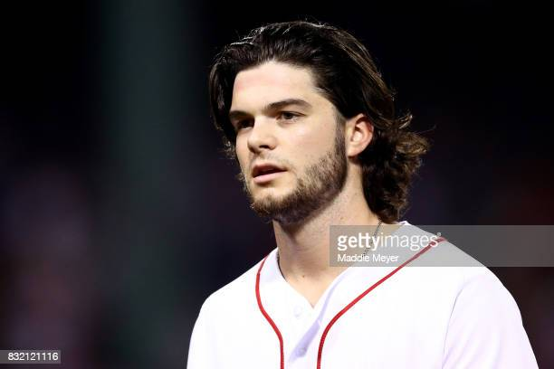 Andrew Benintendi of the Boston Red Sox looks on during the fifth inning against the St Louis Cardinals at Fenway Park on August 15 2017 in Boston...