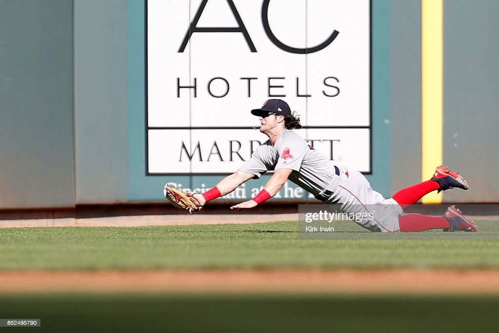 Andrew Benintendi #16 of the Boston Red Sox makes a diving catch on a fly ball hit by Joey Votto #19 of the Cincinnati Reds during the first inning at Great American Ball Park on September 23, 2017 in Cincinnati, Ohio.