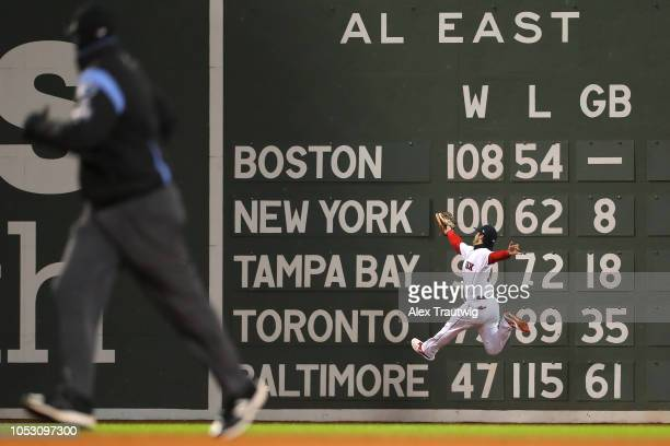 Andrew Benintendi of the Boston Red Sox makes a leaping catch on a line drive by Brian Dozier of the Los Angeles Dodgers in the fifth inning during...