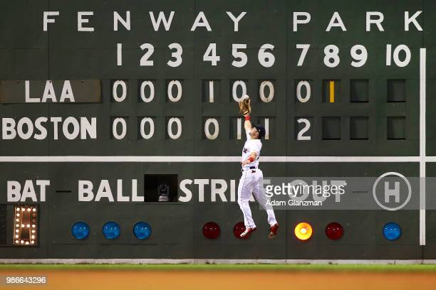 Andrew Benintendi of the Boston Red Sox makes a leaping catch on the warning track in the eighth inning of a game against the Los Angeles Angels at...