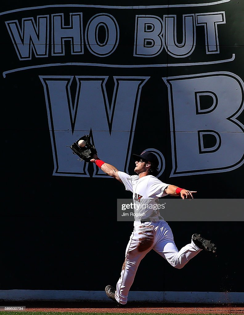 Andrew Benintendi #40 of the Boston Red Sox makes a running catch against the Arizona Diamondbacks in the seventh inning at Fenway Park on August 14, 2016 in Boston, Massachusetts.