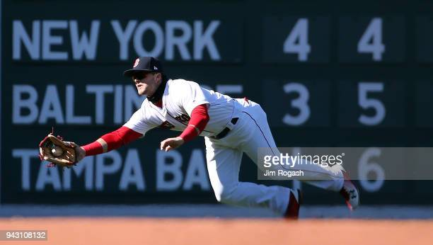 Andrew Benintendi of the Boston Red Sox makes catch on a ball hit by Brad Miller of the Tampa Bay Rays in the eighth inning at Fenway Park on April 7...