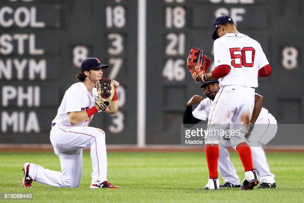 Andrew Benintendi of the Boston Red Sox Mookie Betts and Jackie Bradley Jr #19 celebrate in the outfield after defeating the Toronto Blue Jays 51 at...
