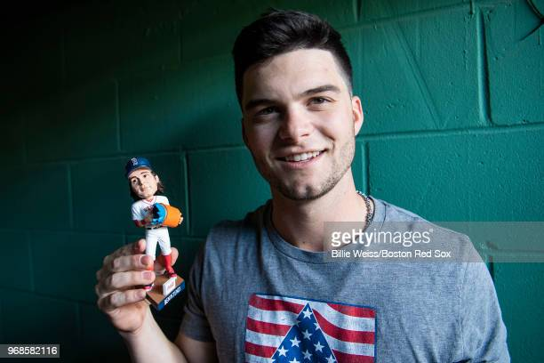 Andrew Benintendi of the Boston Red Sox poses for a photograph with an Andrew Benintendi splash bobblehead giveaway item before a game against the...