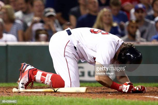 Andrew Benintendi of the Boston Red Sox reacts after being struck with a pitch by JA Happ of the Toronto Blue Jays during the fourth inning at Fenway...