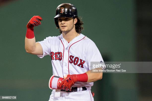 Andrew Benintendi of the Boston Red Sox reacts after hitting an RBI double during the third inning of a game against the Oakland Athletics on...