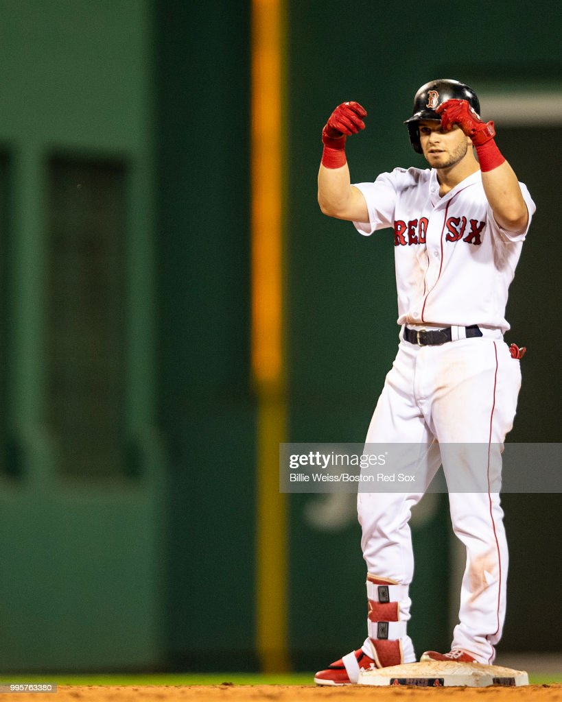 Andrew Benintendi #16 of the Boston Red Sox reacts after hitting an RBI double during the seventh inning of a game against the Texas Rangers on July 10, 2018 at Fenway Park in Boston, Massachusetts.