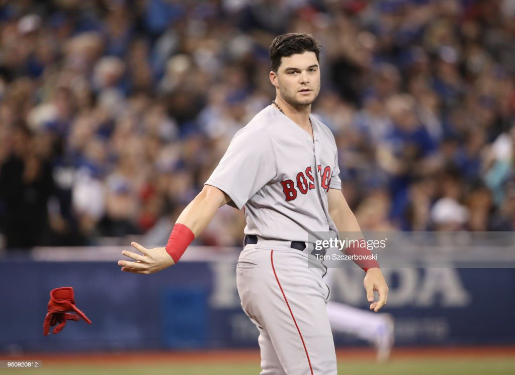 Andrew Benintendi #16 of the Boston Red Sox reacts after striking out in the eighth inning during MLB game action against the Toronto Blue Jays at Rogers Centre on April 24, 2018 in Toronto, Canada.