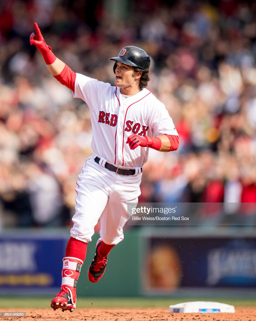 Andrew Benintendi #16 of the Boston Red Sox reacts as he rounds the bases after hitting a three run home run during the fifth inning of the home opener against the Pittsburgh Pirates on April 3, 2017 at Fenway Park in Boston, Massachusetts.