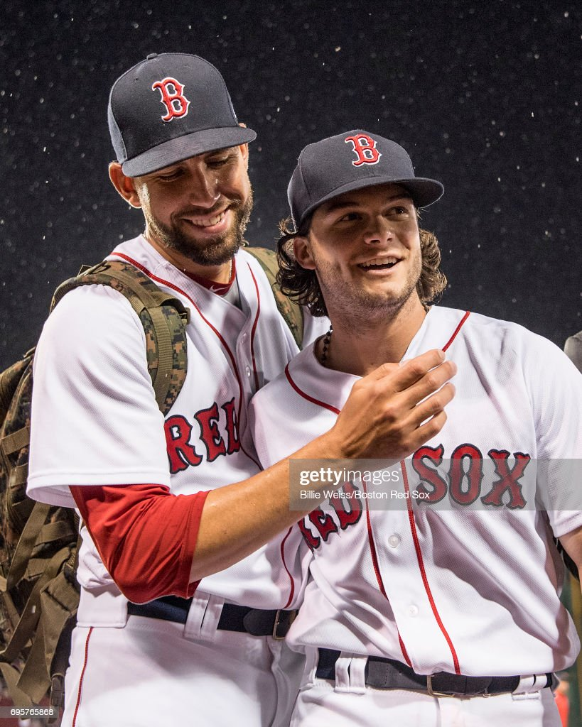 Andrew Benintendi #16 of the Boston Red Sox reacts with Matt Barnes after hitting a walk-off double to end the game against the Philadelphia Phillies on June 13, 2017 at Fenway Park in Boston, Massachusetts.