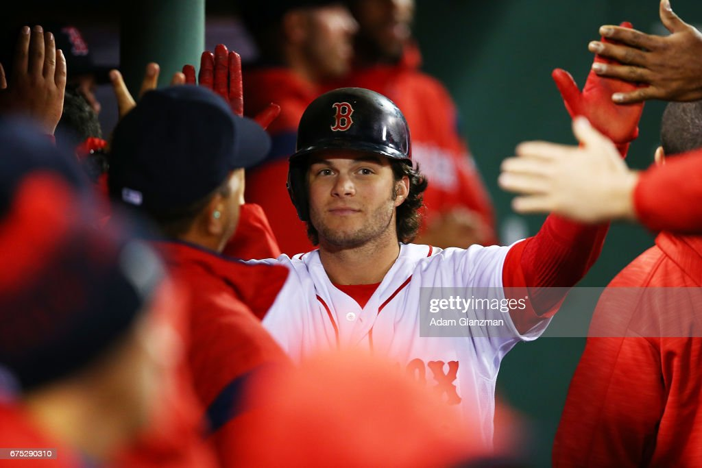 Andrew Benintendi #16 of the Boston Red sox returns to the dugout after scoring in the eighth inning of a game against the Chicago Cubs at Fenway Park on April 30, 2017 in Boston, Massachusetts.