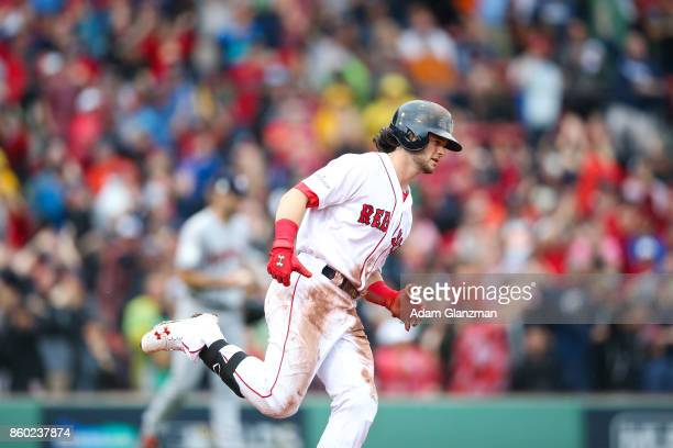 Andrew Benintendi of the Boston Red Sox rounds the bases after hitting a tworun home run in the fifth inning of Game 4 of the American League...