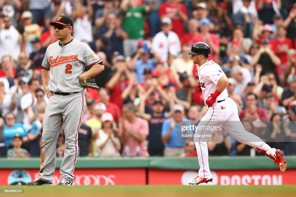 Andrew Benintendi #16 of the Boston Red Sox rounds the bases after hitting a two-run home run in the fifth inning of a game as Danny Valencia #2 of the Baltimore Orioles looks on at Fenway Park on May 20, 2018 in Boston, Massachusetts.