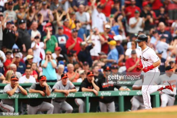 Andrew Benintendi of the Boston Red Sox rounds the bases after hitting a tworun home run in the fifth inning of a game against the Baltimore Orioles...