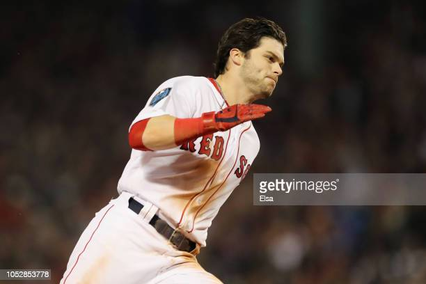 Andrew Benintendi of the Boston Red Sox rounds third base to score a run during the first inning against the Los Angeles Dodgers in Game One of the...