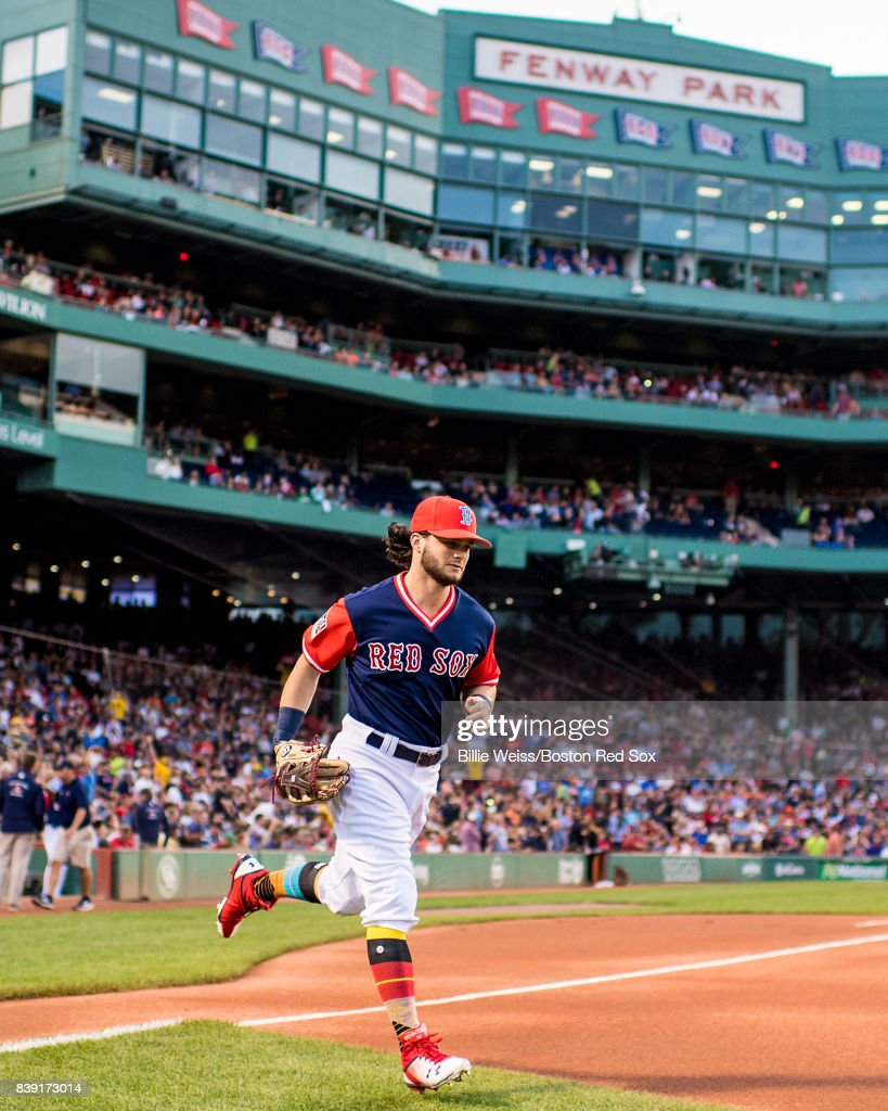Andrew Benintendi #16 of the Boston Red Sox runs onto the field before a game against the Baltimore Orioles on August 25, 2017 at Fenway Park in Boston, Massachusetts.