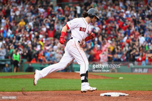 Andrew Benintendi of the Boston Red Sox runs the bases after hitting a tworun home run in the fifth inning against the Houston Astros during game...