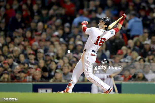 Andrew Benintendi of the Boston Red Sox singles during the third inning against the Los Angeles Dodgers in Game One of the 2018 World Series at...