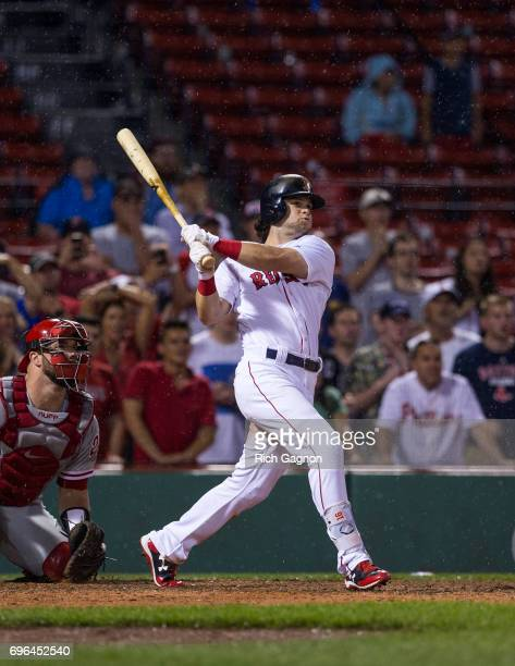 Andrew Benintendi of the Boston Red Sox singles to drive in teammate Xander Bogaerts for the winning run in the 12th inning against the Philadelphia...