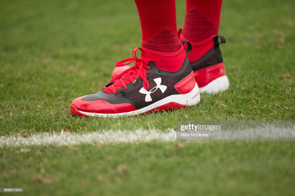 Andrew Benintendi #16 of the Boston Red Sox stretches in his Under Armer cleats before the Spring Training game against the Toronto Blu Jays at Florida Auto Exchange Stadium on March 13, 2017 in Lakeland, Florida.