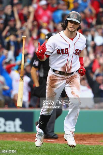 Andrew Benintendi of the Boston Red Sox tosses his bat after hitting a tworun home run in the fifth inning against the Houston Astros during game...