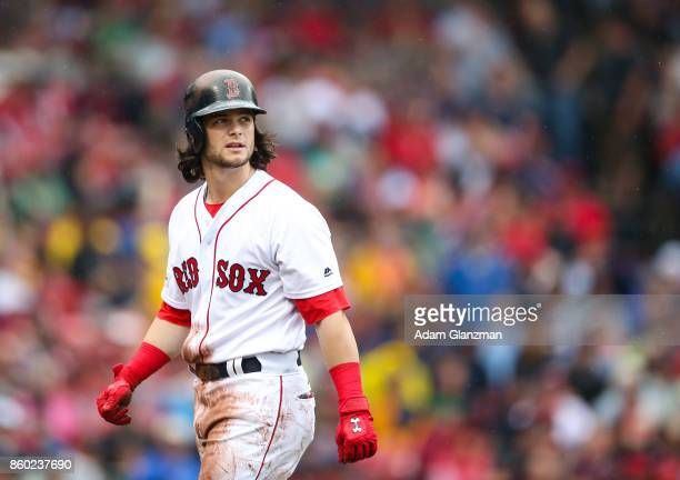 Andrew Benintendi of the Boston Red Sox walks off the field after getting out on a double play in the third inning of Game 4 of the American League...