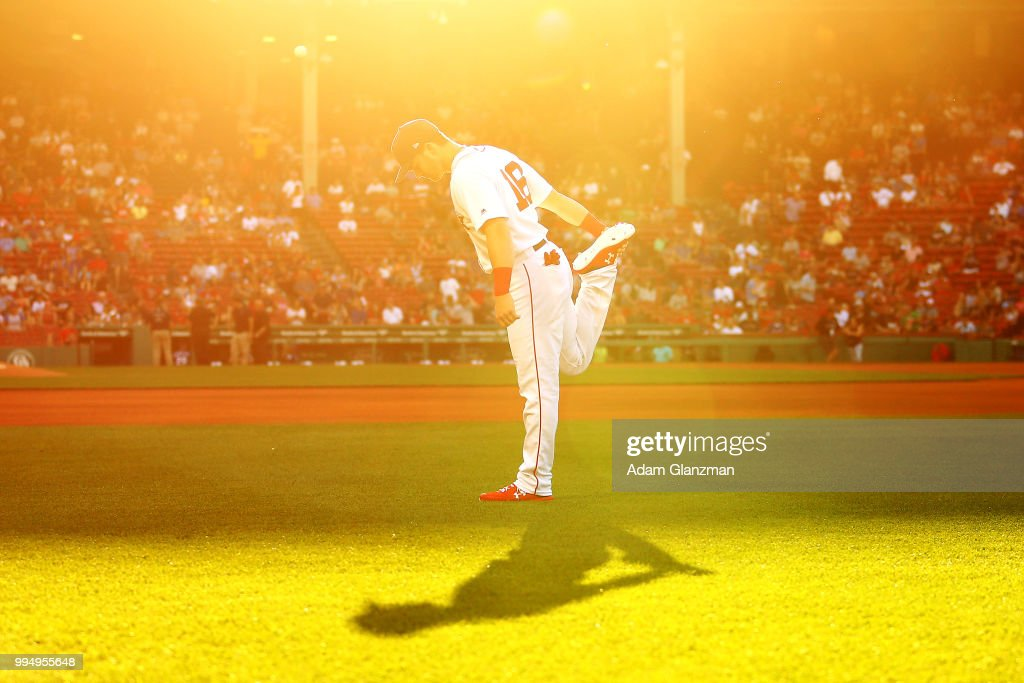 Andrew Benintendi #16 of the Boston Red Sox warms up before a game against the Texas Rangers at Fenway Park on July 9, 2018 in Boston, Massachusetts.