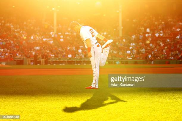 Andrew Benintendi of the Boston Red Sox warms up before a game against the Texas Rangers at Fenway Park on July 9 2018 in Boston Massachusetts