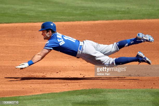 Andrew Benintendi of the Kansas City Royals dives to safely reach second base in the third inning against the Los Angeles Angels during the MLB...