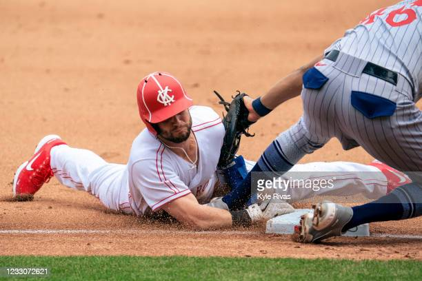 Andrew Benintendi of the Kansas City Royals fails to steal third base from Jeimer Candelario of the Detroit Tigers in the fourth inning at Kauffman...