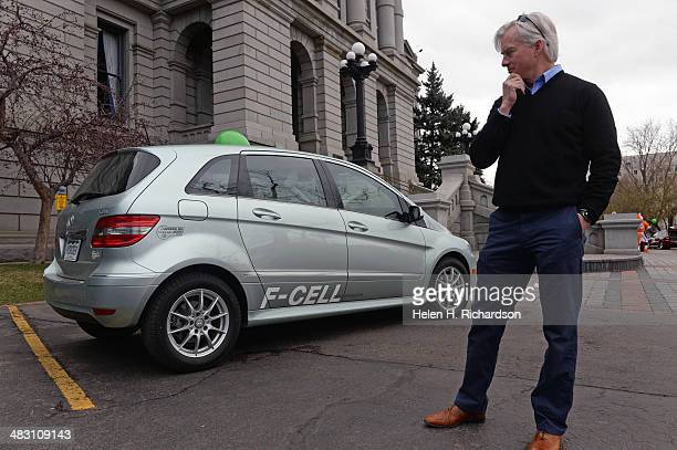 Andrew Bermingham right checks out his new hydrogen fuel cell Mercedes Benz that was part of the Green Car 'Static' parade outside of the state...