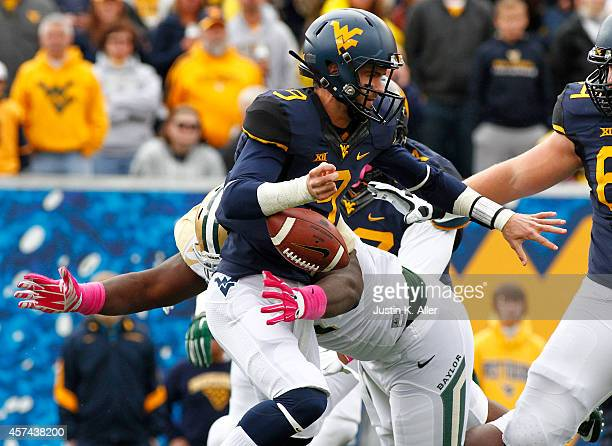 Andrew Billings of the Baylor Bears sacks Clint Trickett of the West Virginia Mountaineers causing a fumble in the first quarter during the game on...